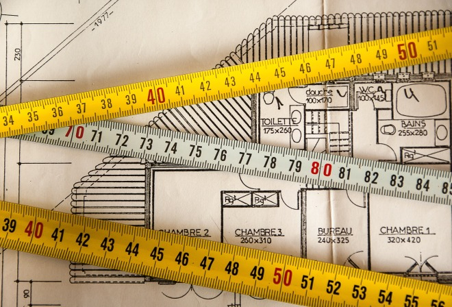 Photo of tape measures across an architect's plan